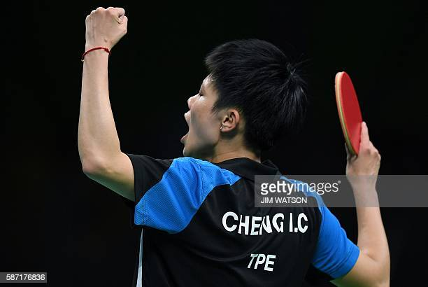 Taiwan's Cheng IChing celebrates in her women's singles qualification round table tennis match at the Riocentro venue during the Rio 2016 Olympic...
