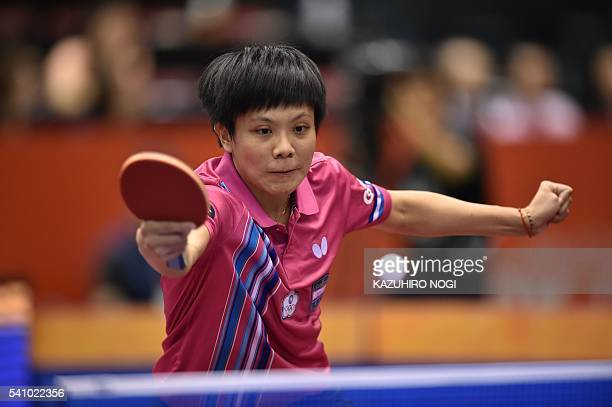 Taiwan's Cheng IChing hits a return against Feng Tianwei of Singapore during their women's singles quarterfinal table tennis match at the ITTF World...