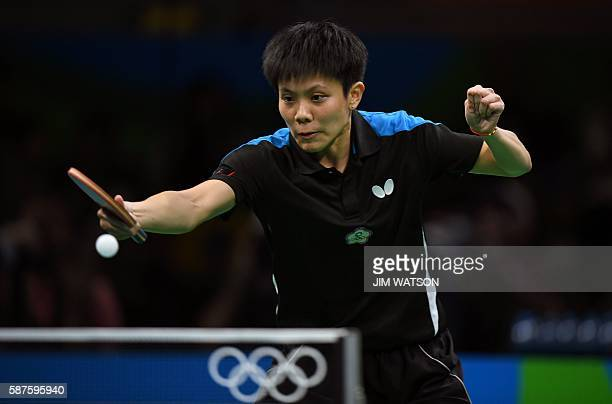 Taiwan's Cheng IChing hits a shot against China's Li Xiaoxia in their women's singles quarterfinal table tennis match at the Riocentro venue during...
