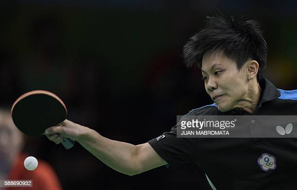 Taiwan's Cheng IChing hits a shot in the women's team qualification round table tennis match against Hong Kong's Lee Ho Ching at the Riocentro venue...