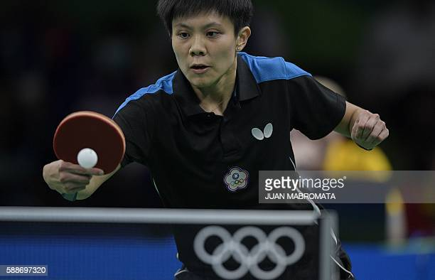 Taiwan's Cheng IChing hits a shot in the women's team qualification round table tennis match against Hong Kong at the Riocentro venue during the Rio...