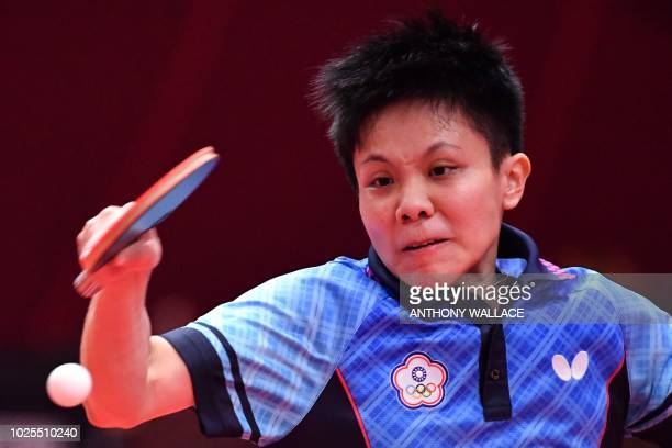 Taiwan's Cheng Iching hits the ball to Singapore's Yu Mengyu during their women's quarterfinal table tennis match at the Asian Games in Jakarta on...