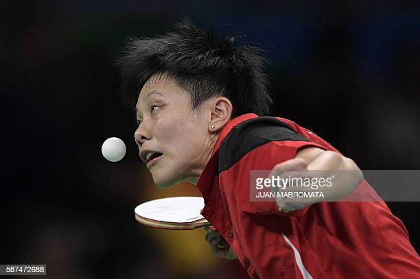 Taiwan's Cheng IChing plays against South Korea's Suh Hyowon during their women's singles qualification round table tennis match at the Riocentro...