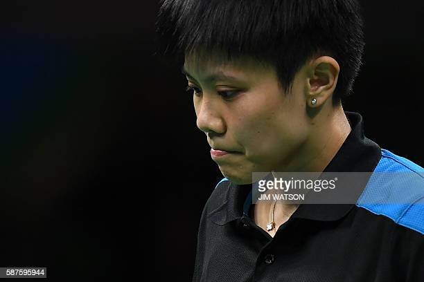 Taiwan's Cheng IChing reacts after a point against China's Li Xiaoxia in their women's singles quarterfinal table tennis match at the Riocentro venue...