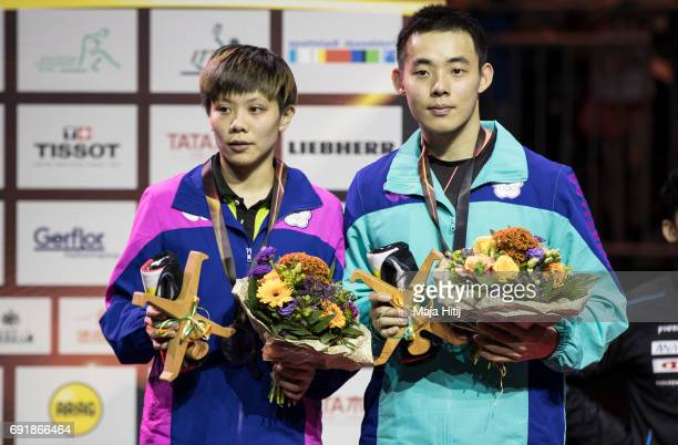 Taiwan's ChienAn Chen and IChing Cheng pose with a silver medal during celebration ceremony after Mixed Doubles Finals at Table Tennis World...