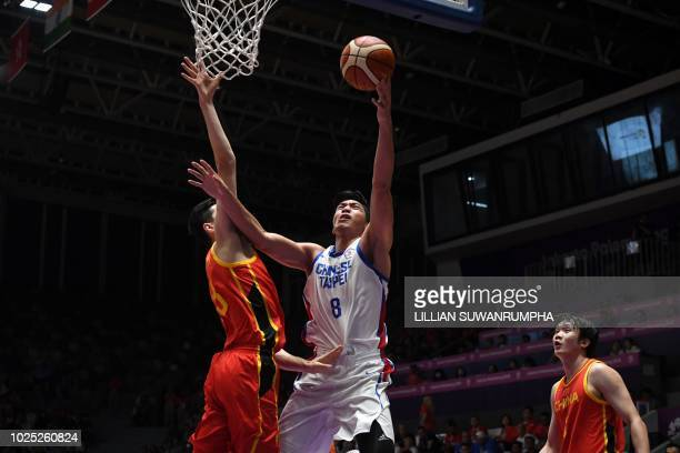Taiwan's Chou Pochen goes for the basket against China's Abudushalamu Abudurexiti in the men's basketball semifinal match between China and Taiwan...