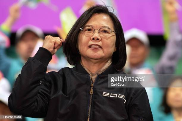 Taiwan's current president and Democratic Progressive Party presidential candidate, Tsai Ing-wen, gestures on stage during a rally ahead of Saturdays...