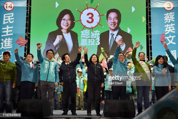 Taiwan's current president and Democratic Progressive Party presidential candidate Tsai Ingwen waves to supporters during a rally ahead of Saturdays...