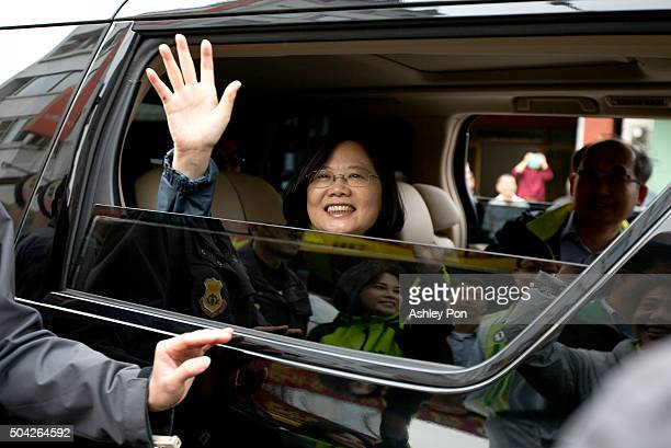 Taiwan's Democratic Progressive Party presidential candidate Tsai Ing-wen , waves supporters after a street rally on January 10, 2016 in Tainan,...
