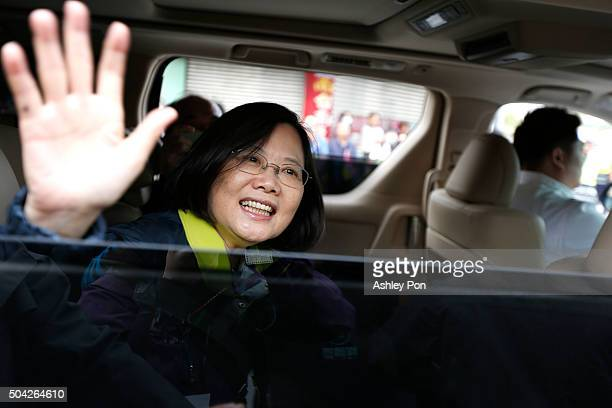 Taiwan's Democratic Progressive Party presidential candidate Tsai Ingwen waves supporters after a street rally on January 10 2016 in Tainan Taiwan...