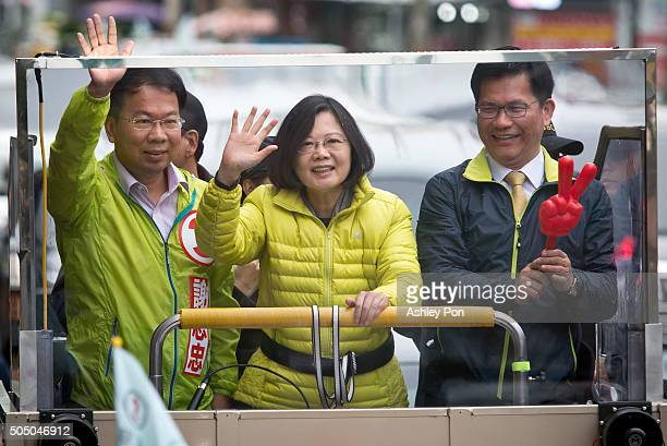 Taiwan's Democratic Progressive Party presidential candidate Tsai Ing-wen, waves supporters from a truck as she parades through the streets of...