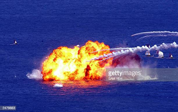 Taiwan's F5E fighter jets drop napalm bombs on mock targets at sea in simulated wargames off Litzechien northeastern Ilan county 04 September 2003 At...