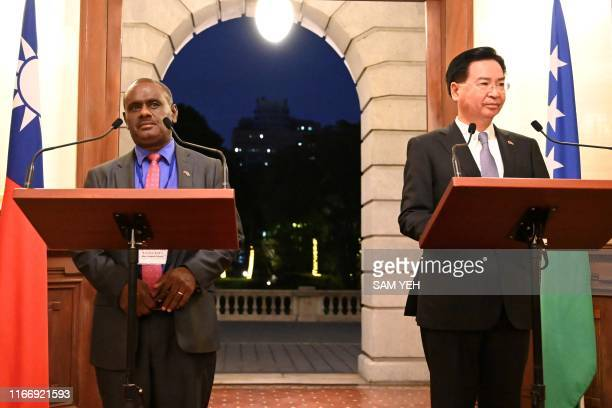 Taiwan's Foreign Minister Joseph Wu takes part in a press conference with Solomon Islands' Foreign Minister Jeremiah Manele at the Taipei Guest House...