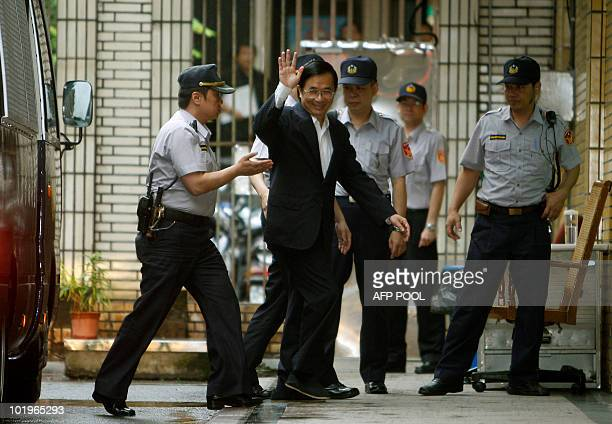 Taiwan's former president Chen Shui-bian waves as he arrives for the ruling in his appeal against a life sentence for corruption at Taiwan's high...