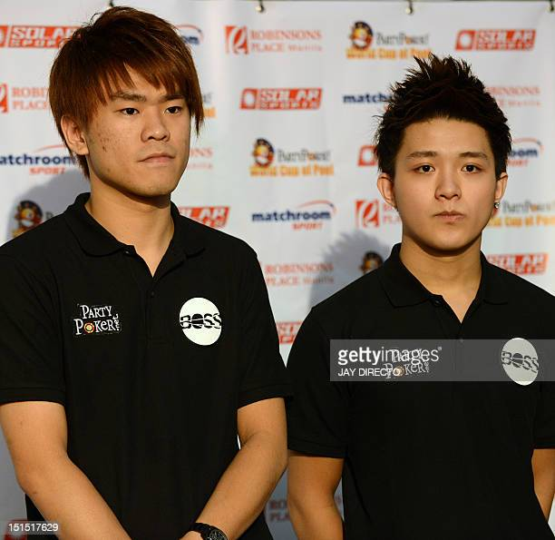Taiwan's Han En Hsu and Hsin Ting Chen pose for photo at the 2012 PartyPokernet World Cup of Pool in Manila on September 8 where they competed...