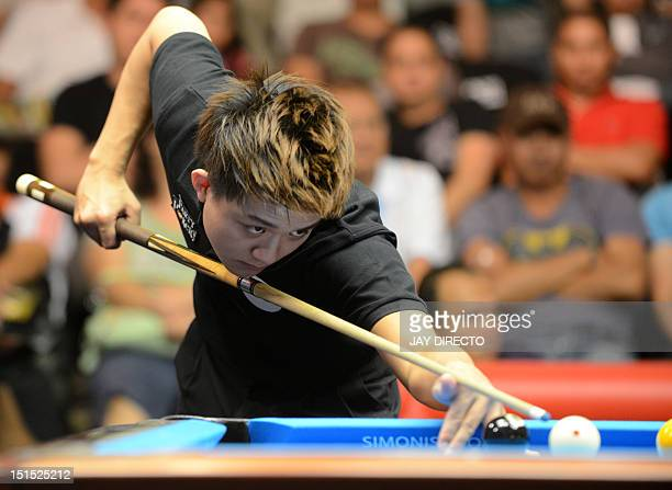 Taiwan's Han En Hsu lines up a shot as he and teammate Hsin Ting Chen compete against Great Britain's Darren Appleton and Chris Melling during the...