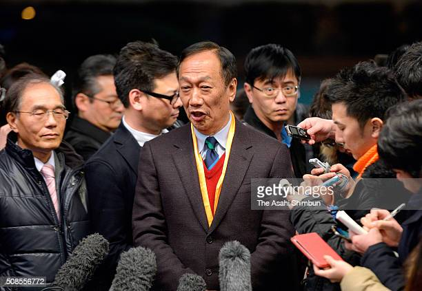 Taiwan's Hon Hai Precision Industry Co trading as Foxconn Technology Group chairman Terry Gou speaks to media reporters after his meeting with borad...
