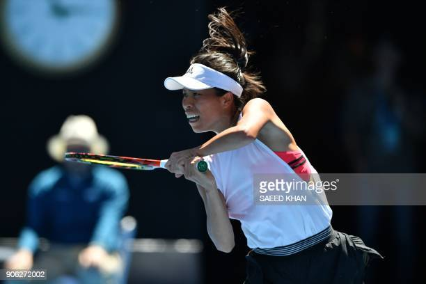 Taiwan's Hsieh SuWei hits a return during their women's singles second round match against Spain's Garbine Muguruza on day four of the Australian...