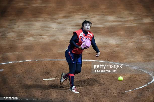 TOPSHOT Taiwan's Lin Suhua pitches during the women's preliminary softball match between China and Taiwan at the 2018 Asian Games in Jakarta on...