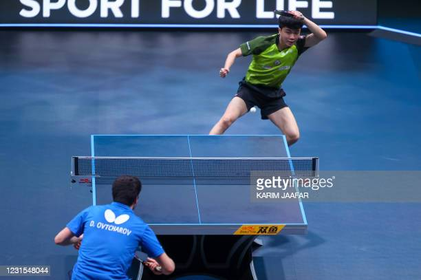 Taiwan's Lin Yun-Ju competes against Germany's Dimitrij Ovtcharov during the finals of the men's singles of the World Table Tennis Middle East Hub in...