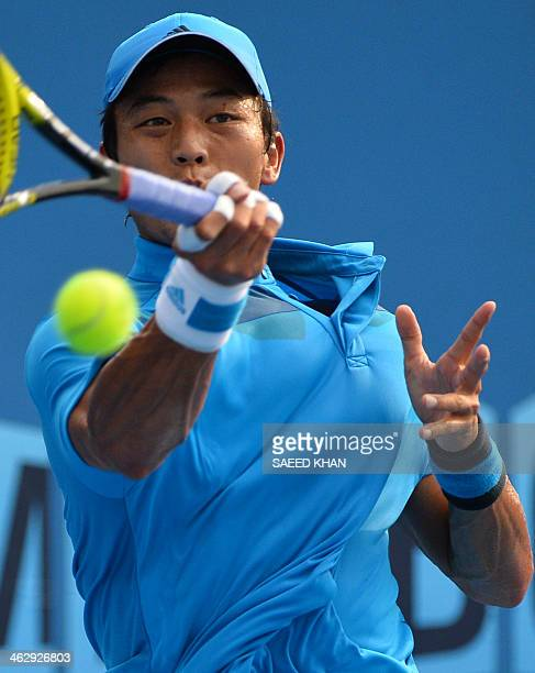 Taiwan's Lu YenHsun plays a shot during his men's singles match against Bulgaria's Grigor Dimitrov on day four of the 2014 Australian Open tennis...