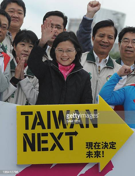 Taiwan's main opposition Democratic Progressive Party presidential candidate Tsai Ing-wen waves to supporters during a election rally in Taipei on...