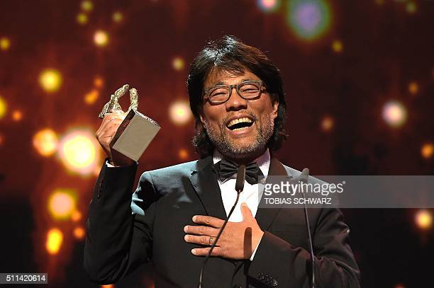 """Taiwan's Mark Lee Ping Bin speaks after receiving the Silver Bear for Outstanding Artistic Contribution for the film """"Chang Jiang Tu"""" during the..."""