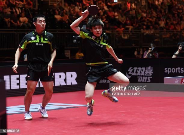 Taiwan's mixed double Chen ChienAn and Cheng IChing play against Japanese mixed double Maharu Yoshimura and Kasumi Ishikawa during the WTTC World...