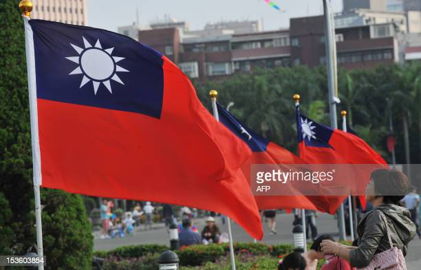 Taiwan's national flags flutter beside Taipei 101 at Sun Yatsen Memorial Hall in Taipei on October 7 2012 AFP PHOTO / Mandy CHENG