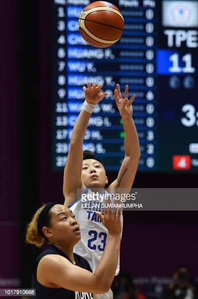Taiwan's Peng Szuchin shoots against Unified Korea's Kim Hanbyul in the women's basketball preliminary group A match between Taiwan and Unified Korea...