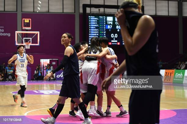 Taiwan's players celebrate after beating Unified Korea in the women's basketball preliminary group A match between Taiwan and Unified Korea during...