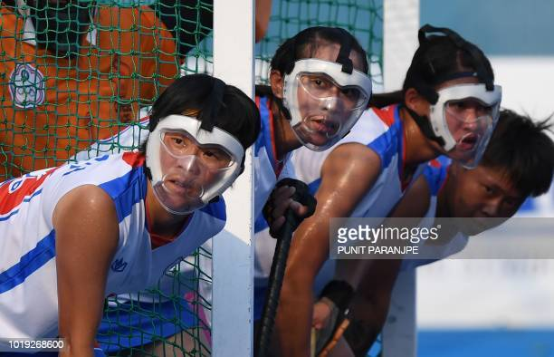 Taiwan's players prepare for a penalty corner during the women's hockey pool A match between Japan and Taiwan at the 2018 Asian Games in Jakarta on...