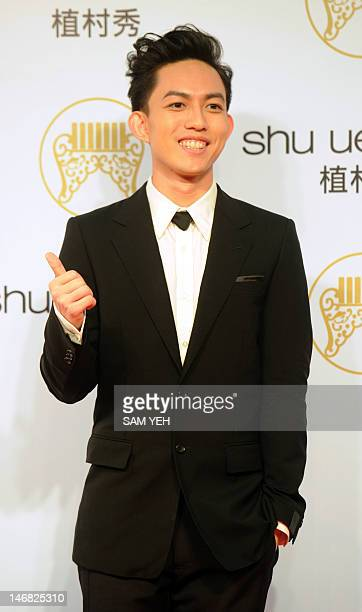 Taiwan's pop music singer Yoga Lin poses for photographs upon his arrival at the 23rd Golden Melody Awards in Taipei on June 23 2012 Performers from...