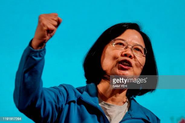 Taiwan's President and presidential candidate from the ruling Democratic Progressive Party Tsai Ingwen gestures during a rally at the Xinzhuang...