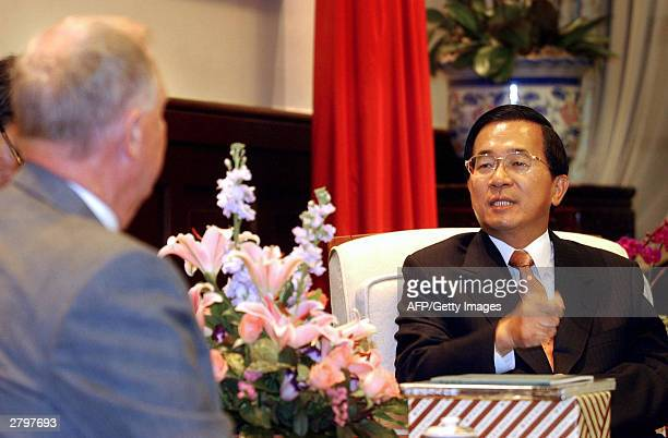 "Taiwan's President Chen Shui-bian gestures as he tells U.S. Congressman Don Burton that China should not oppose a ""defensive referendum"" on the China..."