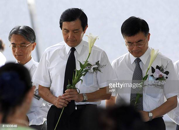 Taiwan's President Ma Yingjeou observes a minute of silence to pay respect to the thousands of people killed while the island was placed under the...