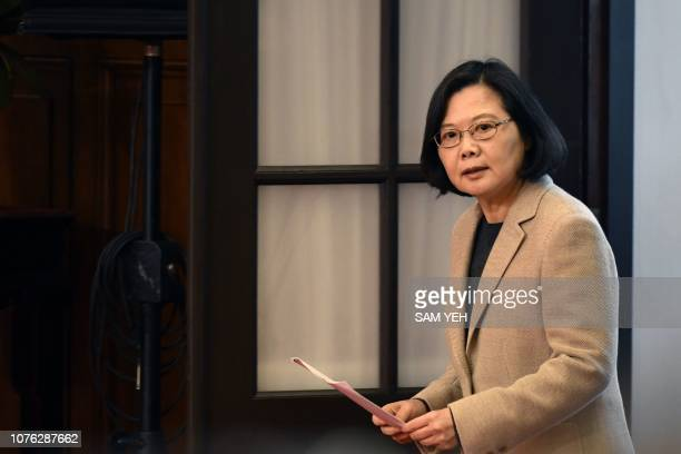 Taiwan's President Tsai Ing-wen arrives for a press conference at the Presidential Palace after the national flag raising ceremony in Taipei on...