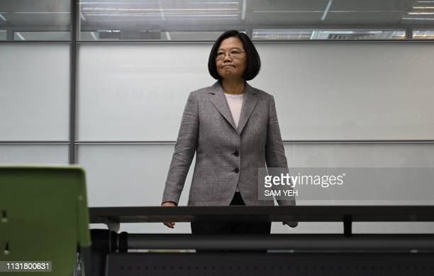 Taiwan's President Tsai Ingwen arrives to register as the ruling Democratic Progressive Party 2020 presidential candidate at the party's headquarter...