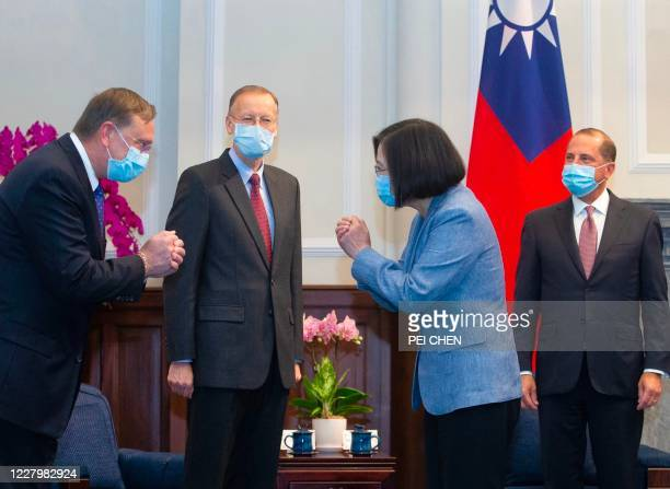 Taiwan's President Tsai Ing-wen gestures to a US official as US Secretary of Health and Human Services Alex Azar and director of the American of...