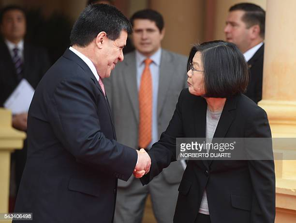 Taiwan's President Tsai Ingwen is welcomed by Paraguayan President Horacio Cartes upon her arrival at the presidential palace in Asuncion on June 28...