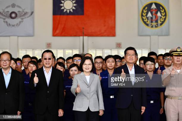 Taiwan's President Tsai Ing-wen poses for photographs with members of the military during her visit to Penghu Air Force Base on Magong island in the...