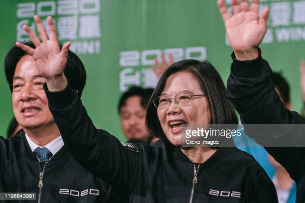 Taiwan's President Tsai Ing-wen waves to supporters outside her campaign headquarters and declared victory in Taiwan's election on January 11, 2020...
