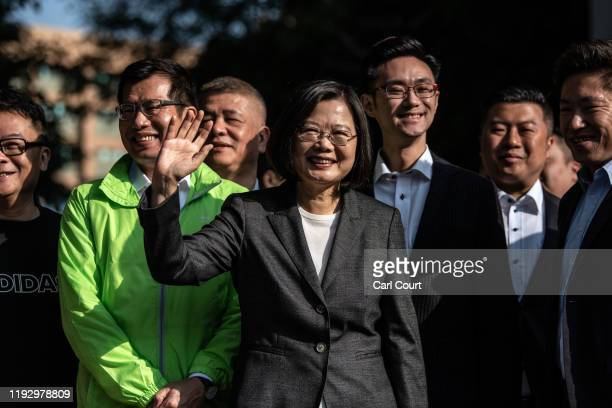 Taiwans President Tsai Ing-wen waves to the media as she leaves after casting her vote in the presidential election on January 11, 2020 in Taipei,...