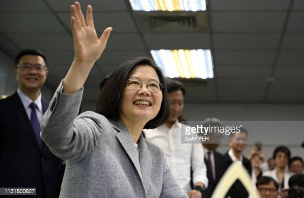 Taiwan's President Tsai Ingwen waves while registering as the ruling Democratic Progressive Party 2020 presidential candidate at the party's...