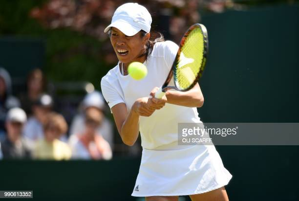 Taiwan's SuWei Hsieh returns against Russia's Anastasia Pavlyuchenkova during their women's singles first round match on the second day of the 2018...