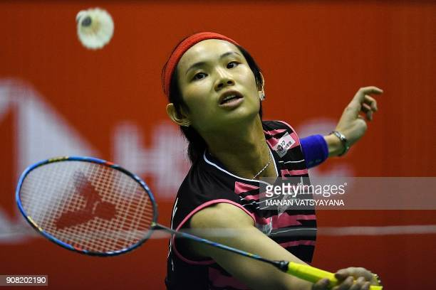 TOPSHOT Taiwan's Tai Tzu Ying hits a return against Thailand's Ratchanok Intanon during their women's singles final match at the 2018 Malaysia...