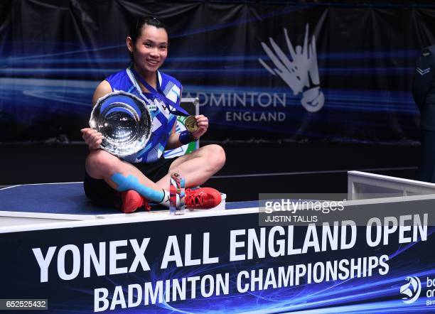 Taiwan's Tai Tzu Ying poses for a photograph with her trophy and her medal after her victory over Thailand's Ratchanok Intanon in the women's singles...