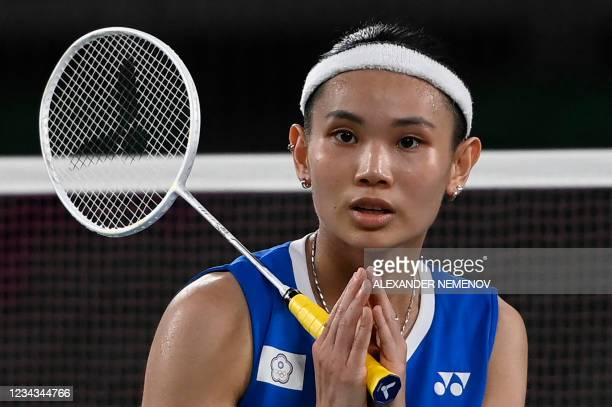 Taiwan's Tai Tzu-ying celebrates after beating India's P. V. Sindhu in their women's singles badminton semi-final match during the Tokyo 2020 Olympic...