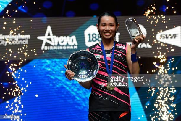 Taiwan's Tai Tzuying poses on the podium after beating Japan's Akane Yamaguchi in the women's singles final at the All England Open Badminton...