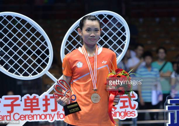 Taiwan's Tai Tzuying stands on the podium after winning the women's singles final against Japan's Akane Yamaguchi at the 2017 Badminton Asia...